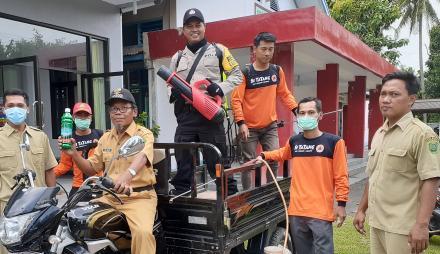 Cegah Penyebaran Virus Corona, Pemerintah Desa Tirtomulyo Lakukan Penyemprotan Desinfektan